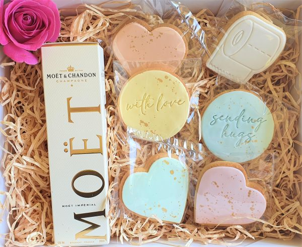 a gift hamper to send friends in lockdown cookies with love messages and toilet paper cookie moet and a card