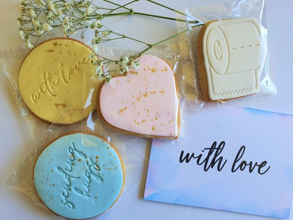 examples of cookies from lockdown love hamper including hearts and toilet paper sugar cookies and with love gift card