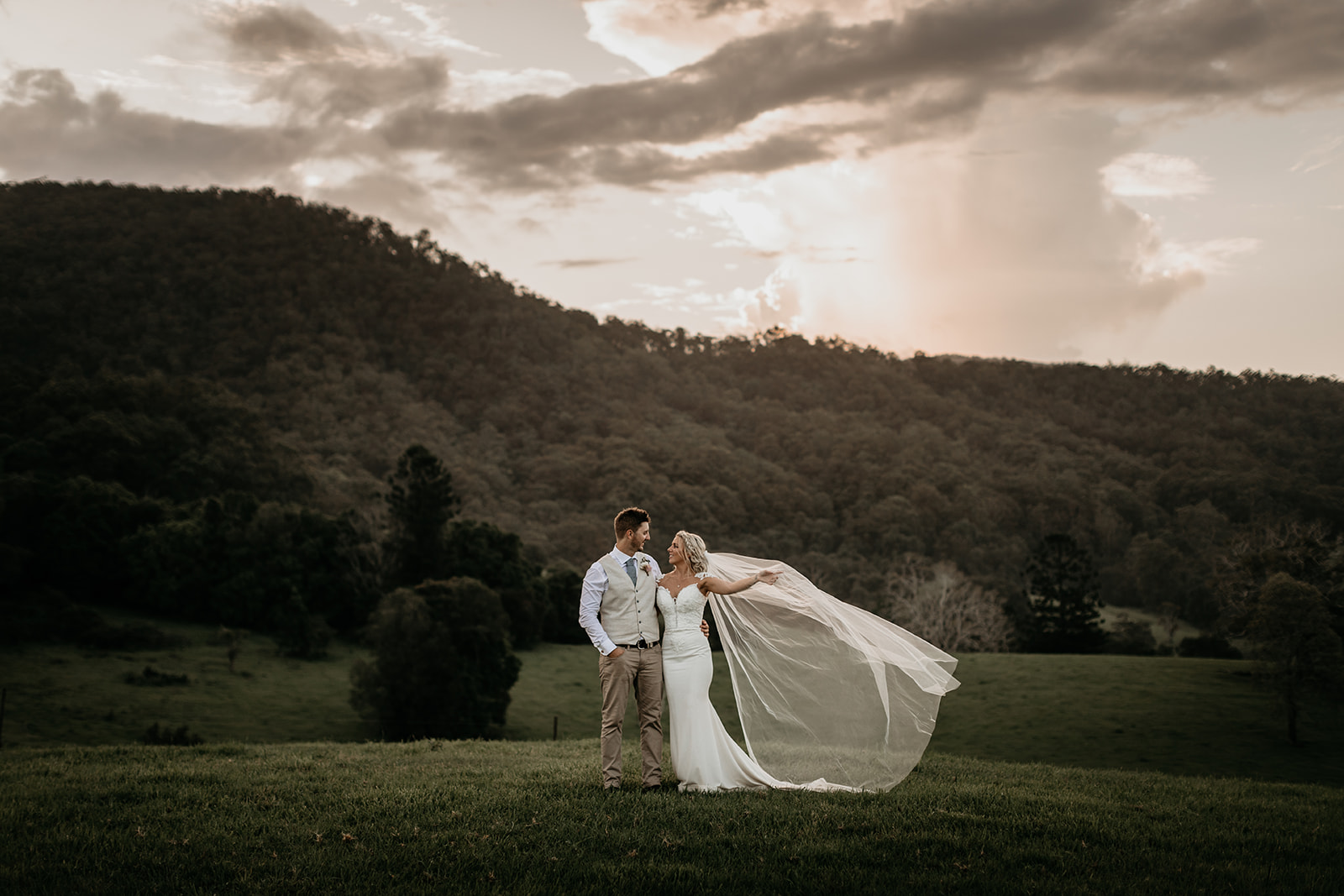 bride and groom in front of beautiful mountainscape